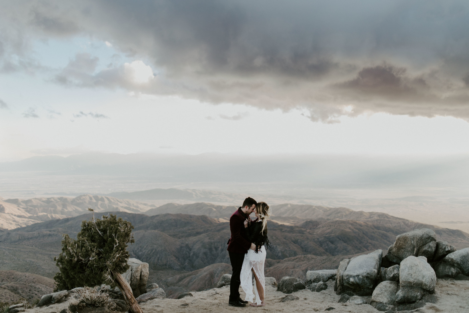 Jeremy and Alyssa face each other. Elopement wedding photography at Joshua Tree National Park by Sienna Plus Josh.