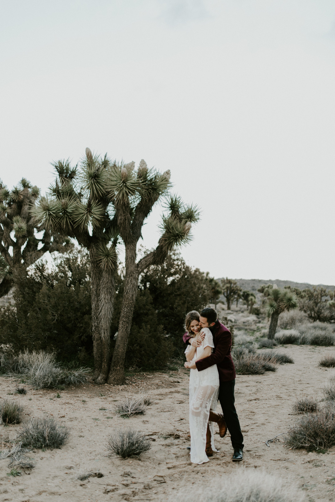 Jeremy and Alyssa hug. Elopement wedding photography at Joshua Tree National Park by Sienna Plus Josh.