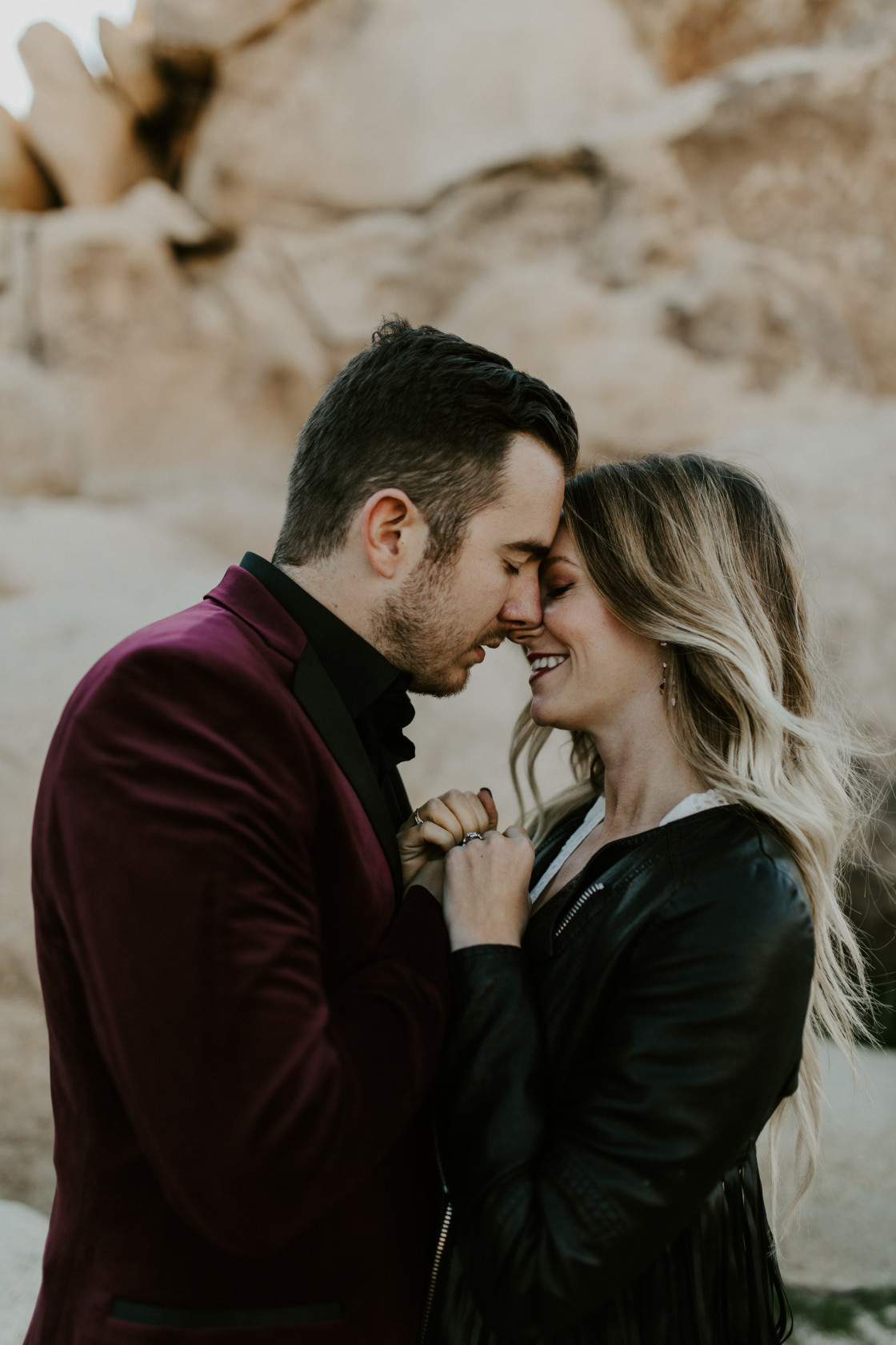 Alyssa and Jeremy go in for a kiss. Elopement wedding photography at Joshua Tree National Park by Sienna Plus Josh.