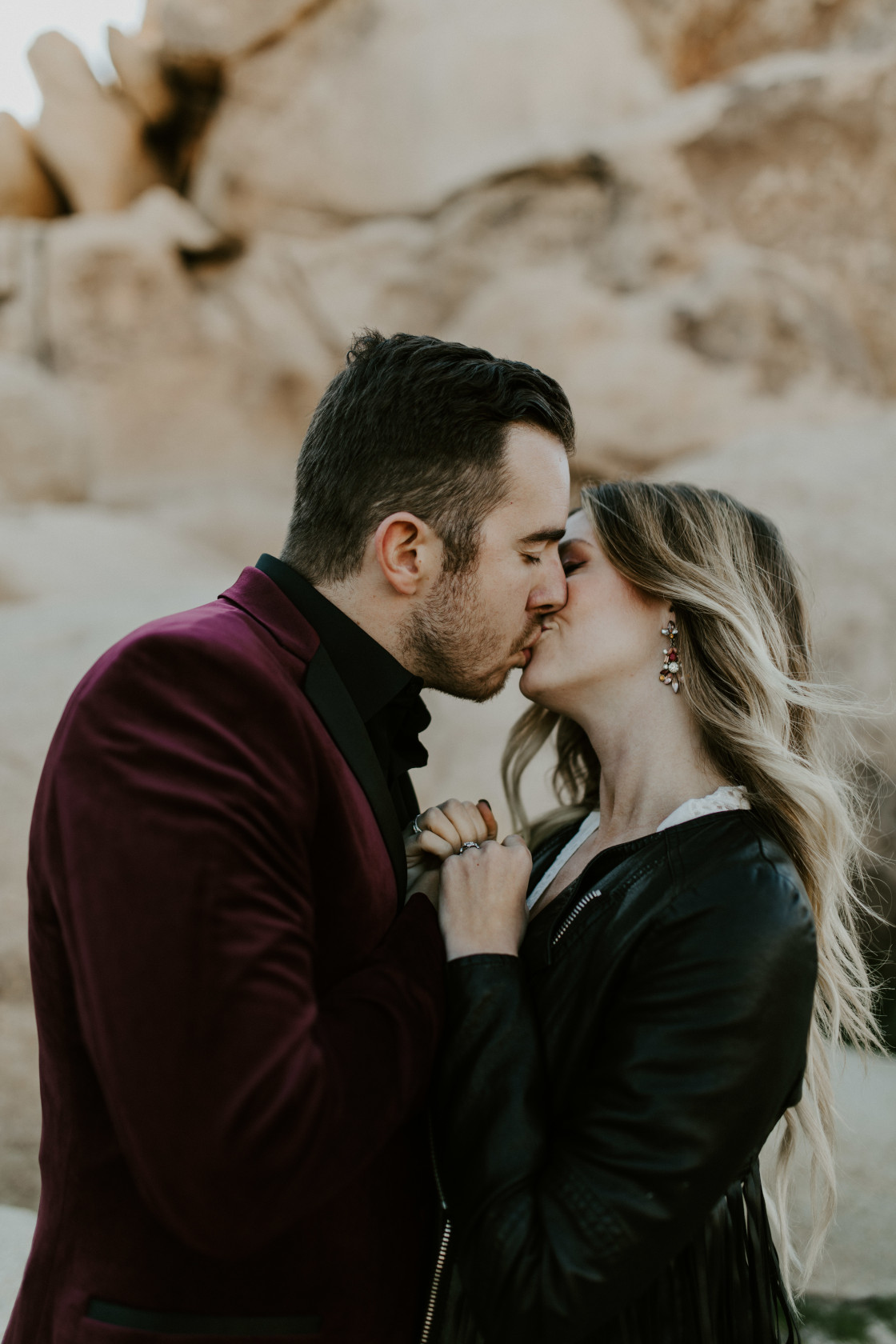 Alyssa and Jeremy go in for a kiss at Joshua Tree National Park, CA Elopement wedding photography at Joshua Tree National Park by Sienna Plus Josh.