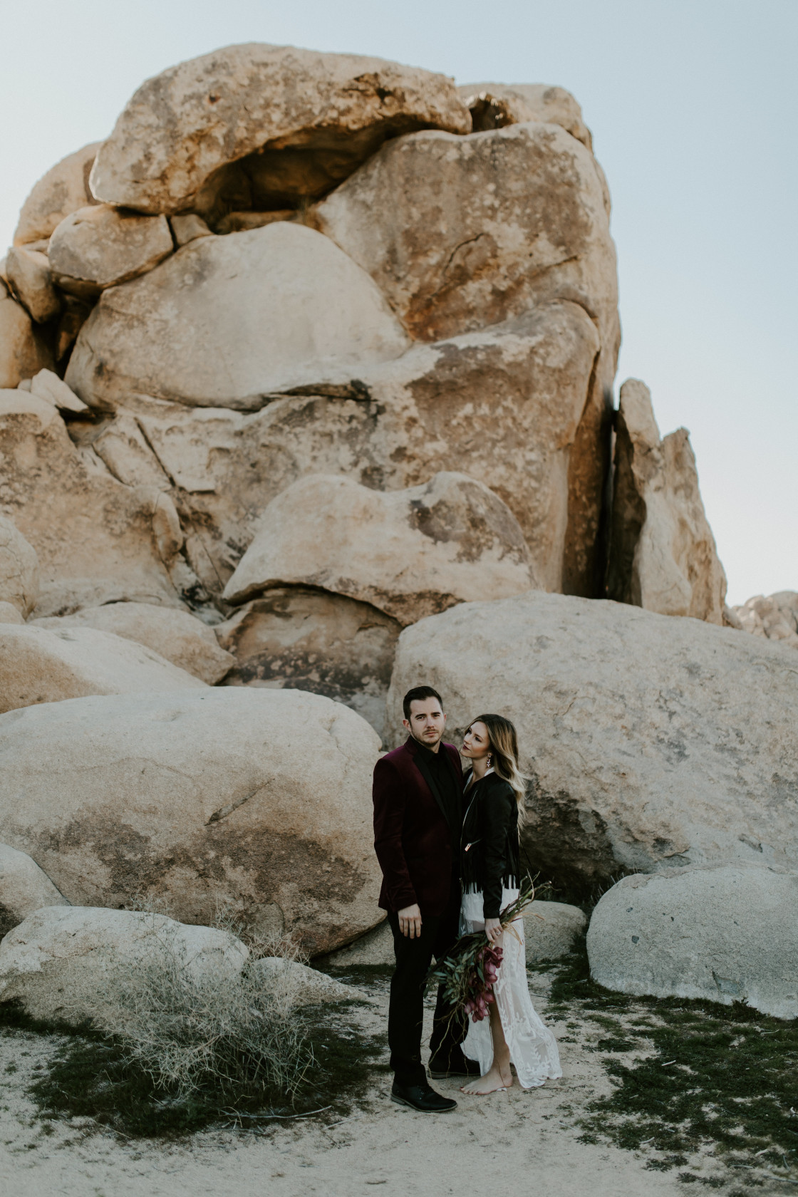 Jeremy and Alyssa stand side by side at Joshua Tree National Park, CA Elopement wedding photography at Joshua Tree National Park by Sienna Plus Josh.