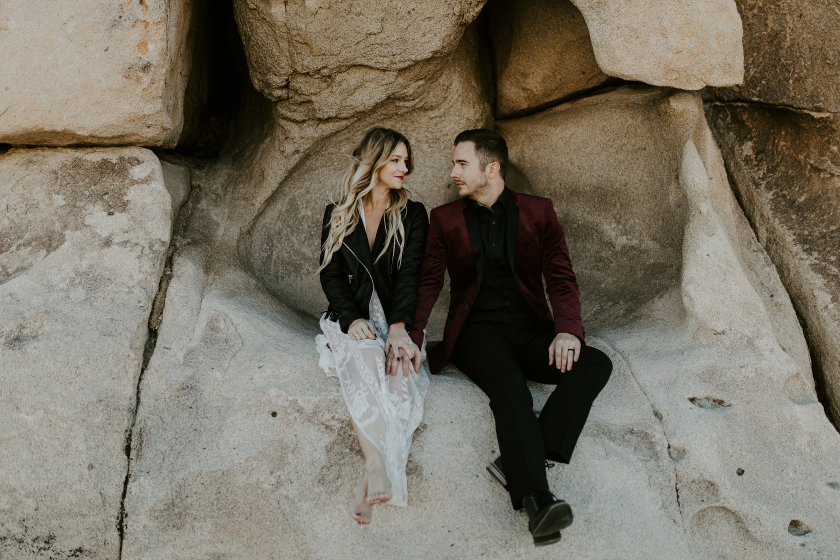 Jeremy and Alyssa sit along the trail at Joshua Tree National Park. Elopement wedding photography at Joshua Tree National Park by Sienna Plus Josh.