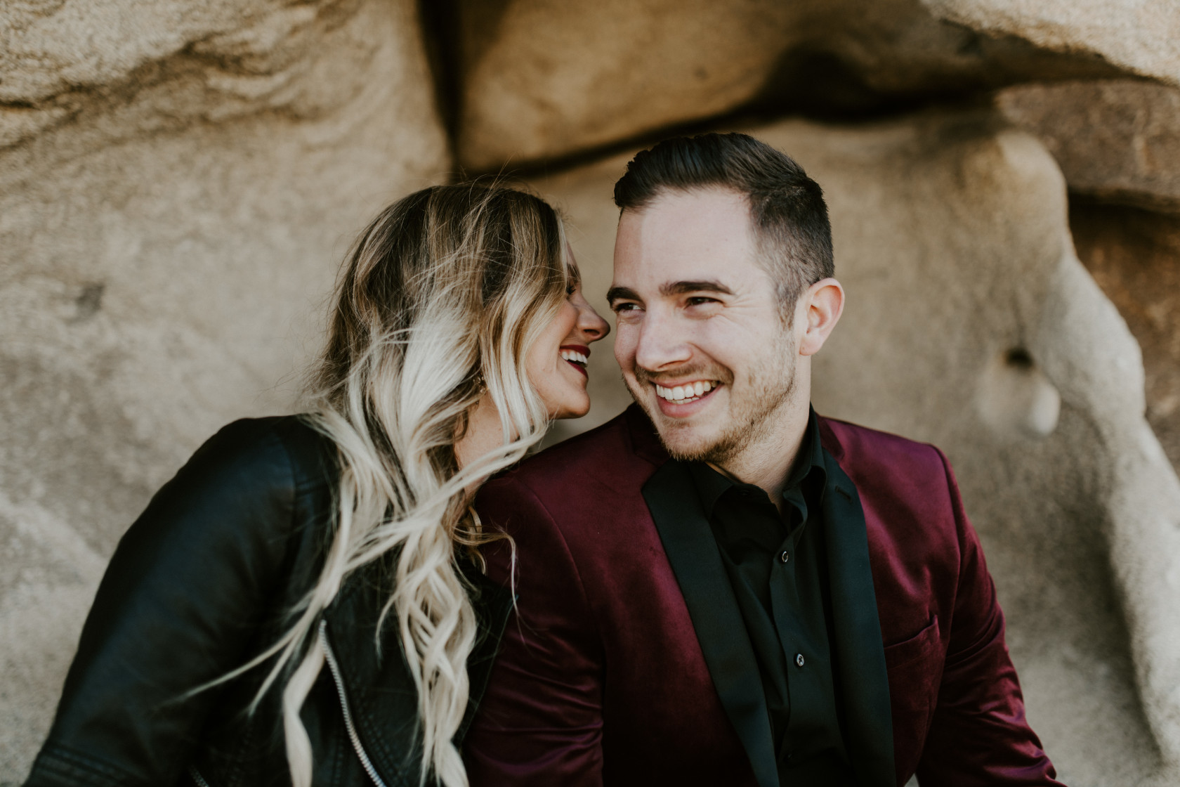 Alyssa goes in to kiss Jeremy. Elopement wedding photography at Joshua Tree National Park by Sienna Plus Josh.