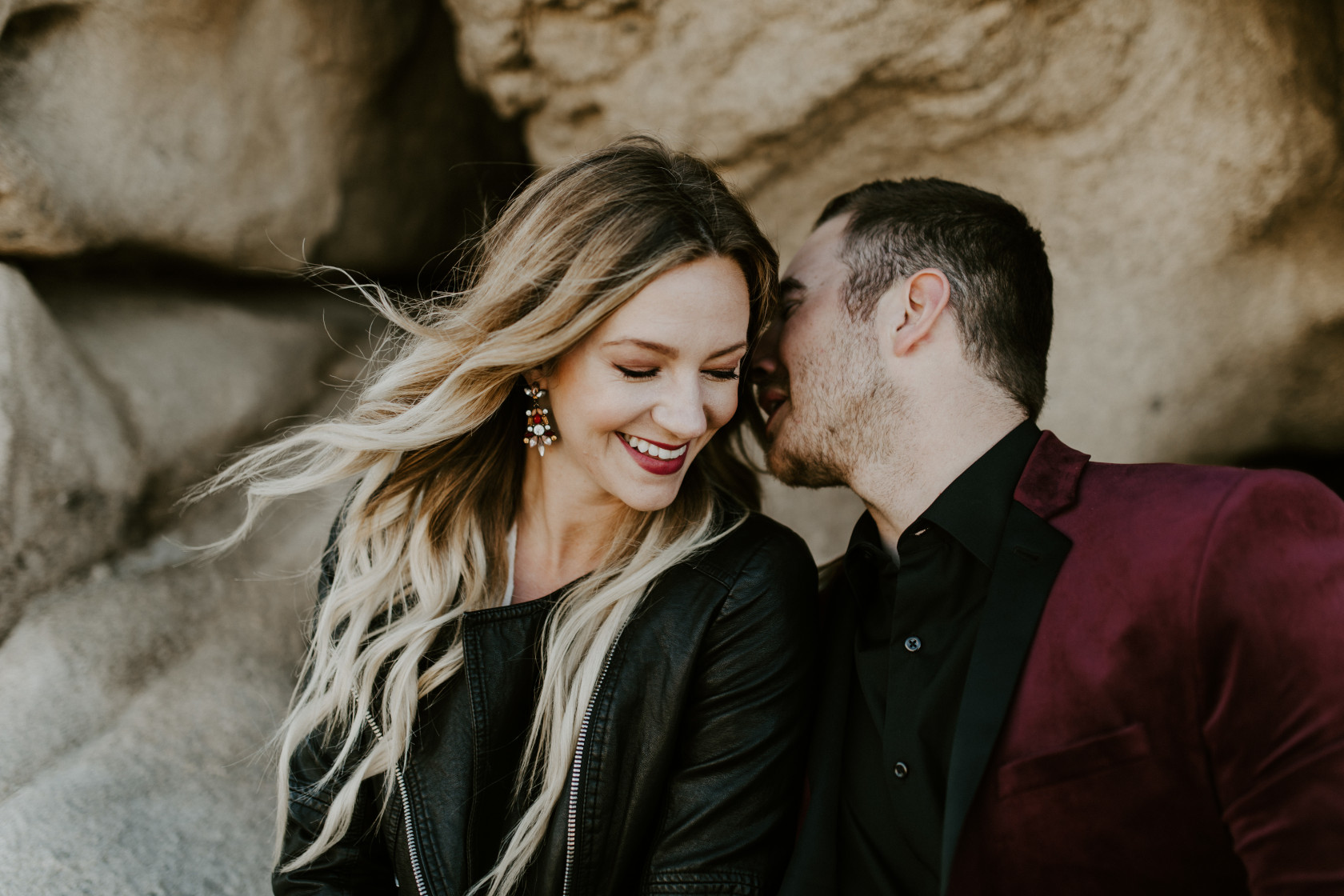 Jeremy whispers to Alyssa. Elopement wedding photography at Joshua Tree National Park by Sienna Plus Josh.