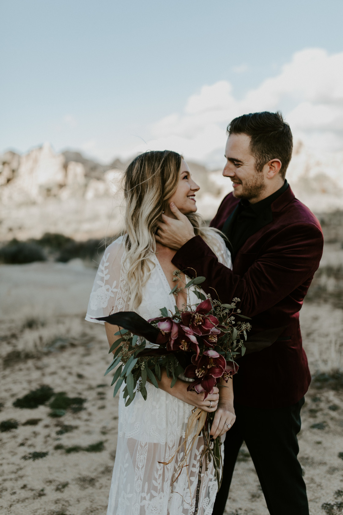 Alyssa and Jeremy stand side by side at Joshua Tree National Park. Elopement wedding photography at Joshua Tree National Park by Sienna Plus Josh.