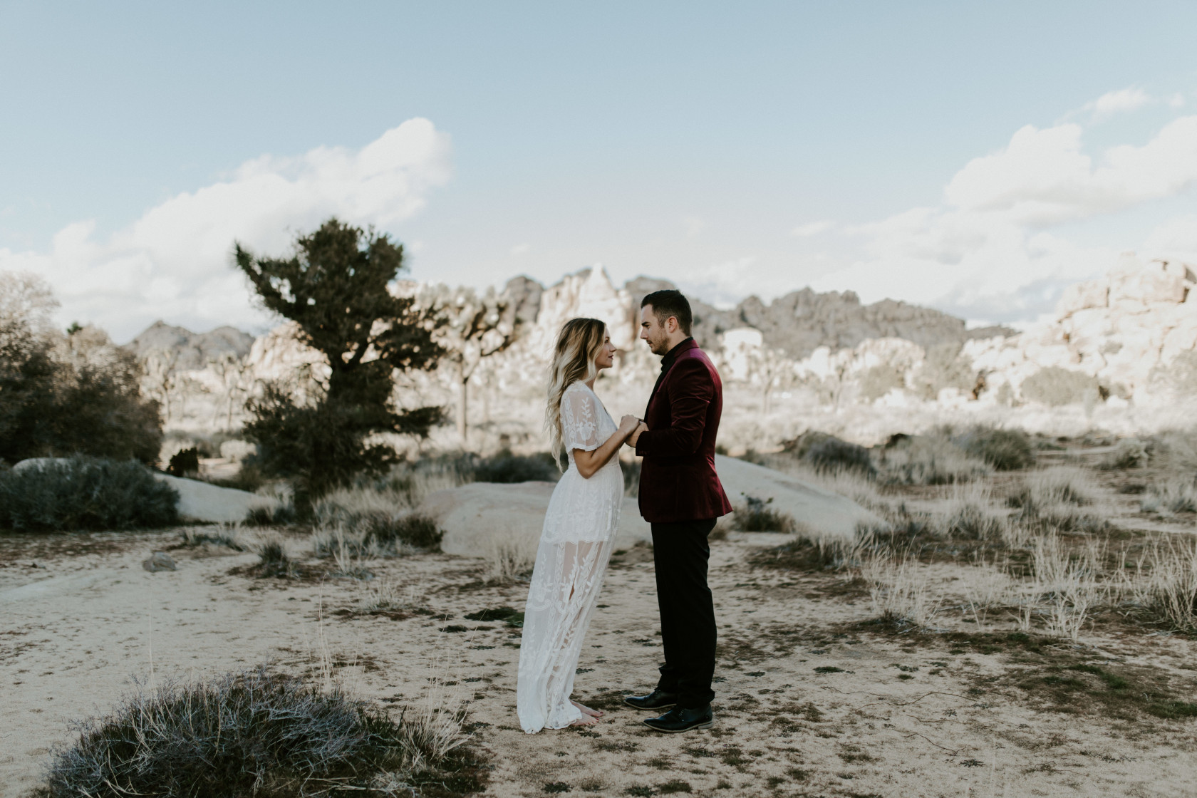 Alyssa and Jeremy face each other on the sand of Joshua Tree National Park Joshua Tree National Park, CA Elopement wedding photography at Joshua Tree National Park by Sienna Plus Josh.