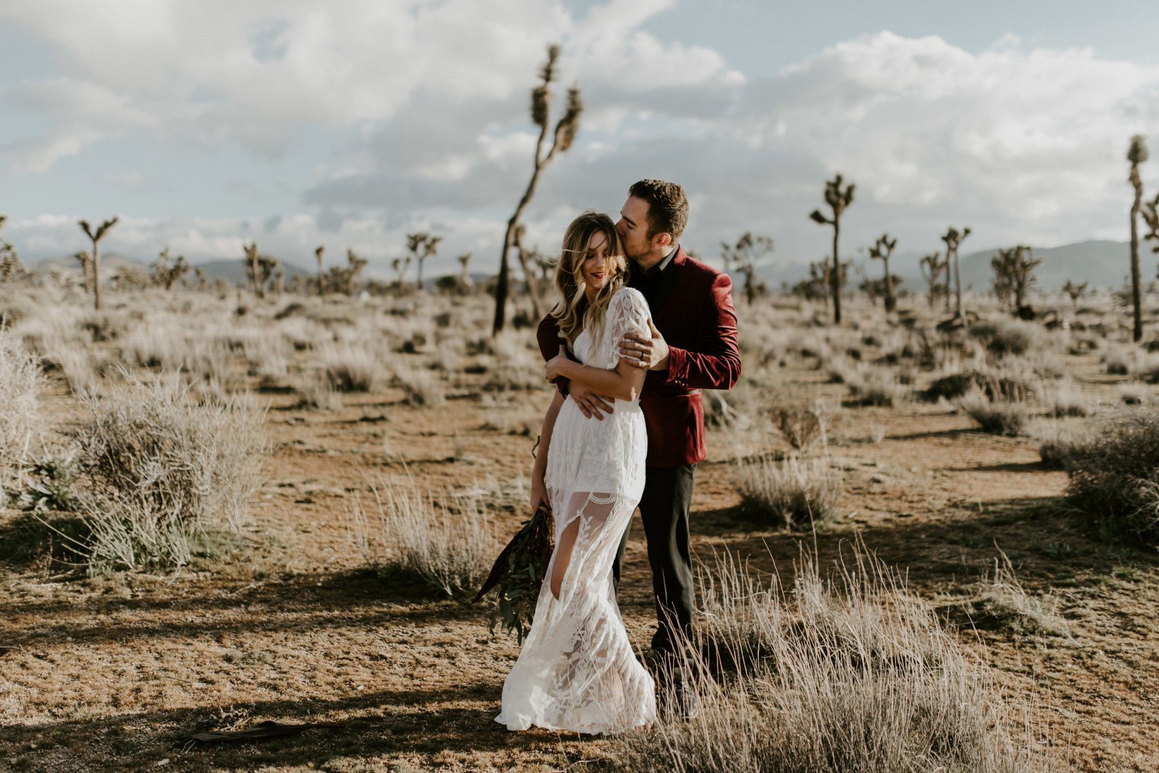 Jeremy kisses Alyssa in the middle of Joshua Tree National Park at Joshua Tree National Park, CA Elopement wedding photography at Joshua Tree National Park by Sienna Plus Josh.