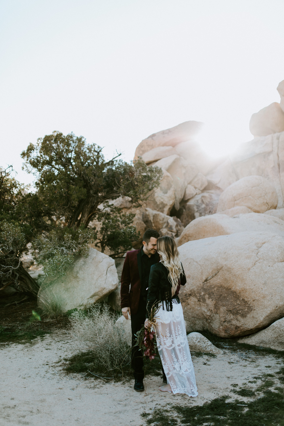Jeremy and Alyssa on the trail to Joshua Tree National Park. Elopement wedding photography at Joshua Tree National Park by Sienna Plus Josh.