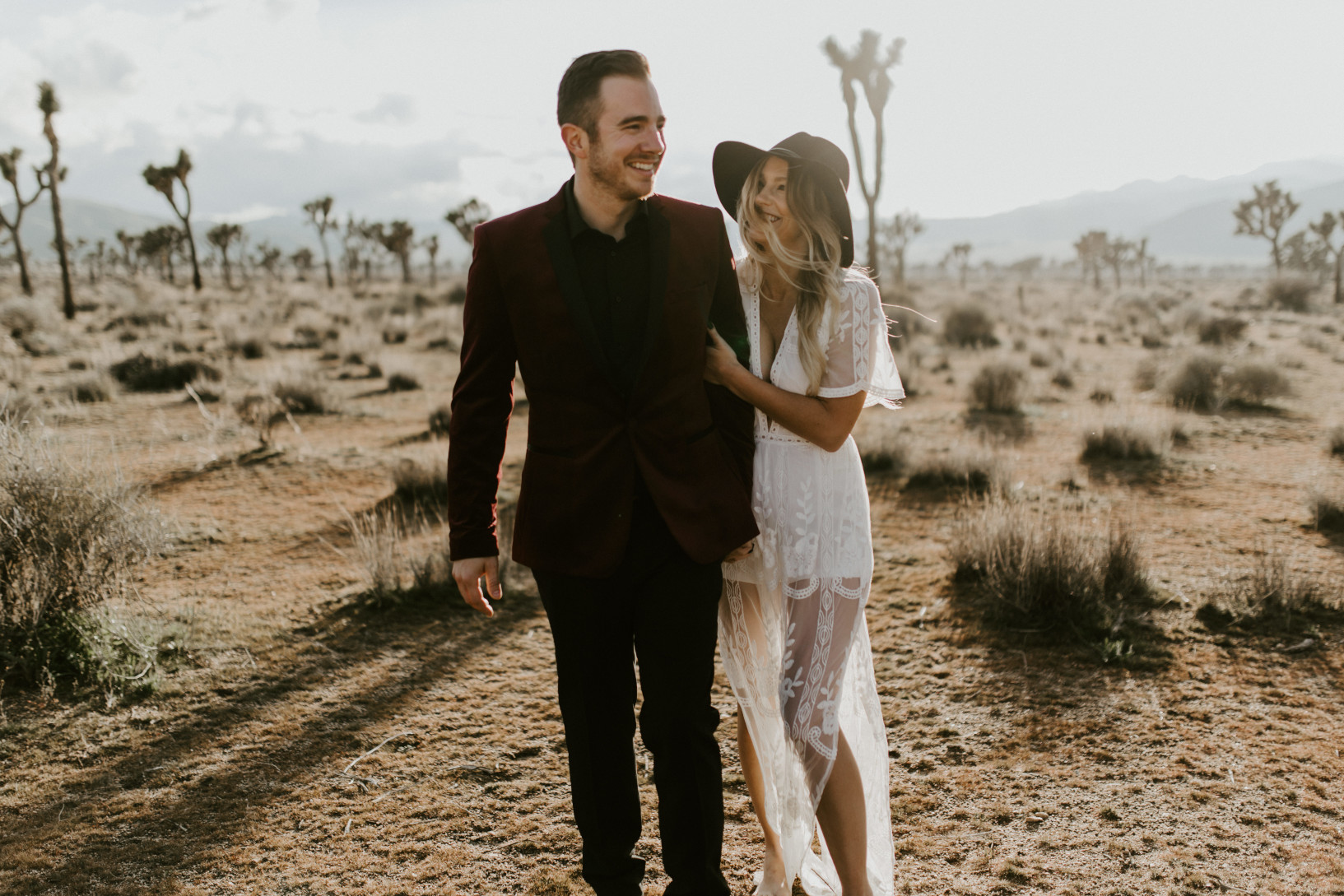 Jeremy and Alyssa stroll through Joshua Tree National Park. Elopement wedding photography at Joshua Tree National Park by Sienna Plus Josh.