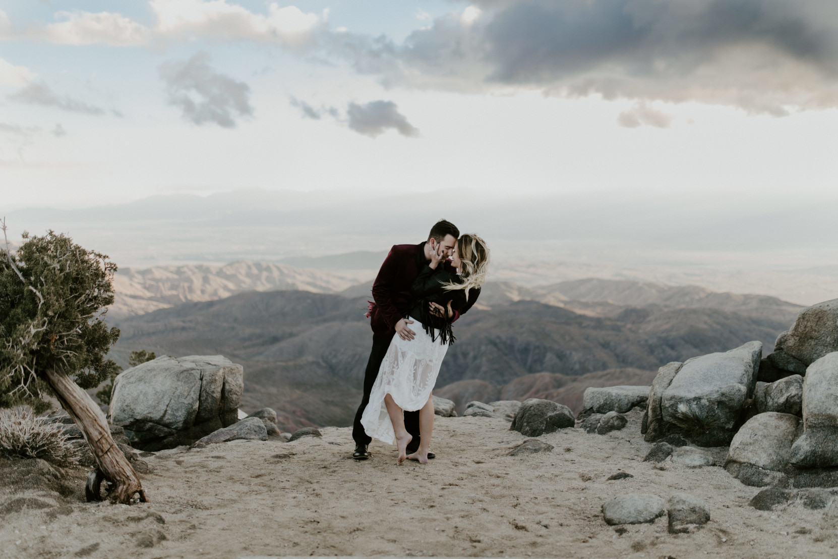 Alyssa and Jeremy kiss with a view Joshua Tree National Park, CA Elopement wedding photography at Joshua Tree National Park by Sienna Plus Josh.